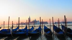 Gondolas moored along Riva degli Schiavoni looking out towards San Giorgio Maggiore