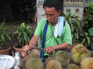 Vendor cutting up a durian in Bangkok, Thailand