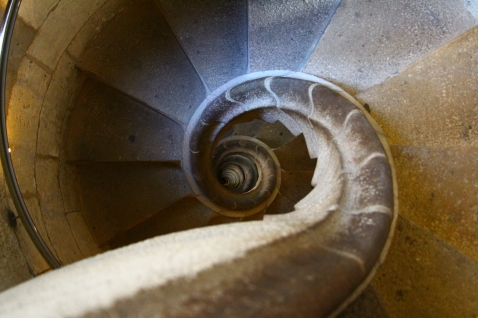 A spiraling staircase on the way down from the Passion Tower at La Sagrada Familia