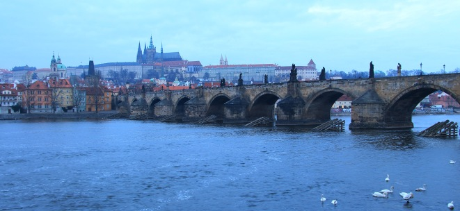 Charles Bridge with Prague Castle complex as a backdrop.