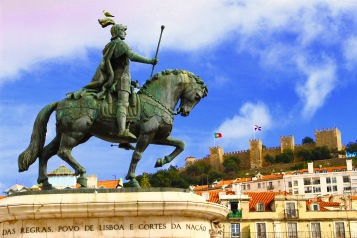 At Praça da Figueira in Baixa with the statue of Dom Joao I (or King John I), and Castelo Sao Jorge in the background.