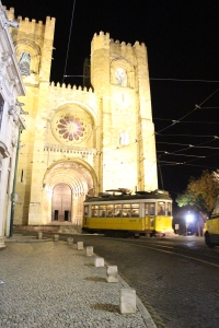 The iconic Tram 28 can be seen in front of the Lisbon cathedral.