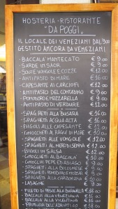Typical restaurant menu board...have to squint to make out the small print for coperto.